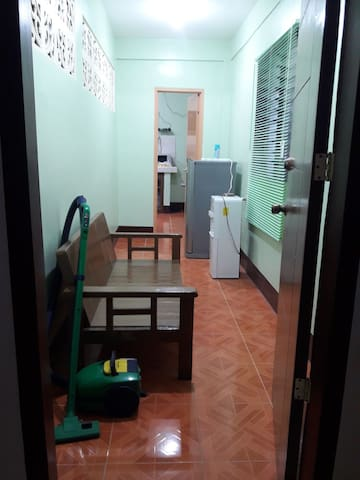 This is the entrance door which goes to a separate room furnished with a sofa,  water dispenser with hot and cold water,  refrigerator and the router for the wifi which serve the ground floor and second floor.