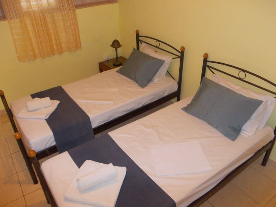 Single beds at second room.