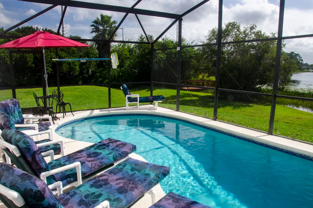 Relax in the pool with wonderful views of Lake Thomas