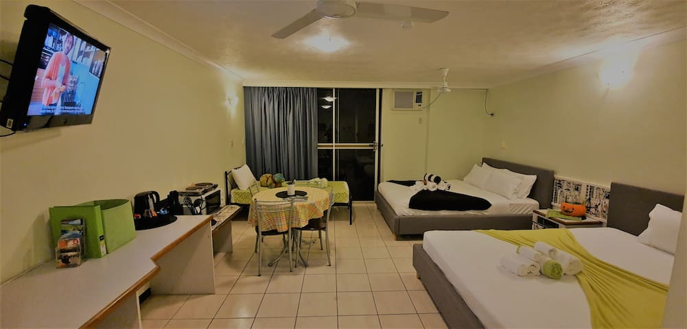 42 sqm studio unit with 2 queen size beds and a singe bed