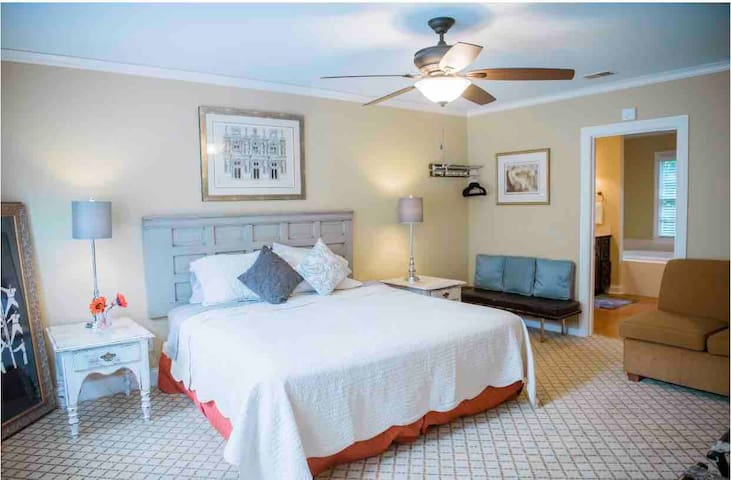 Well now! This is the master! (It should be called the retreat!) big queen bed with hang out couch, windows on the back yard and a huge bathroom attached.