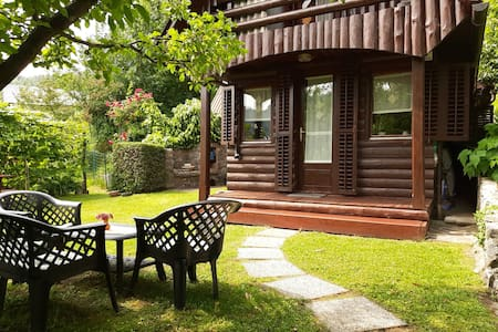Idrija: Wooden cabin surrounded by flower gardens
