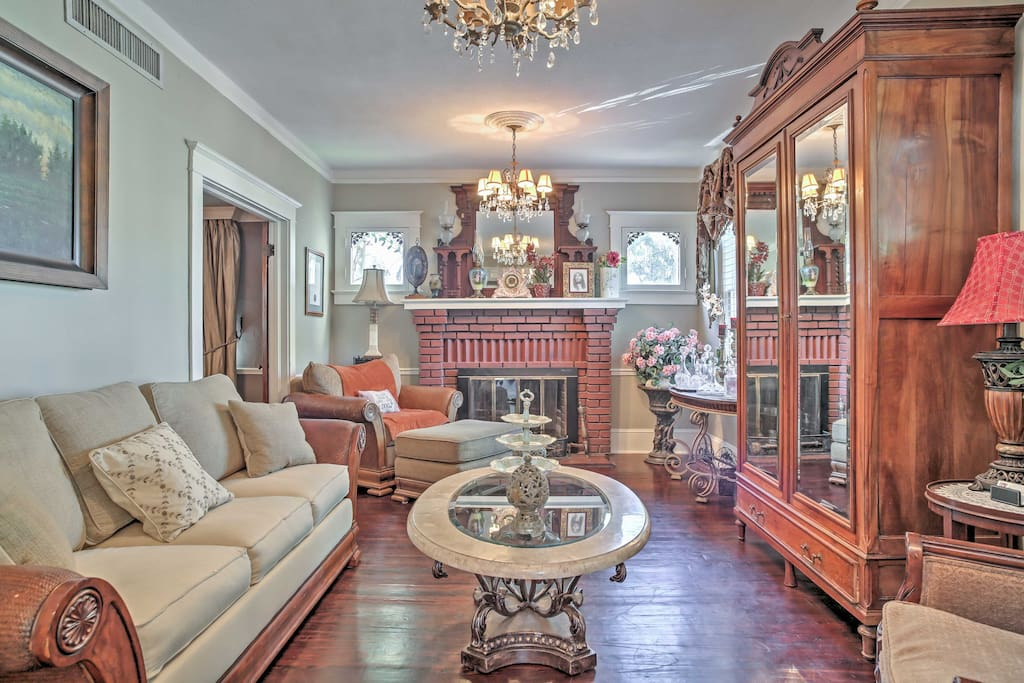 High-end, traditional decor, stunning chandeliers, and original hardwood floors throughout create a rich and inviting environment.