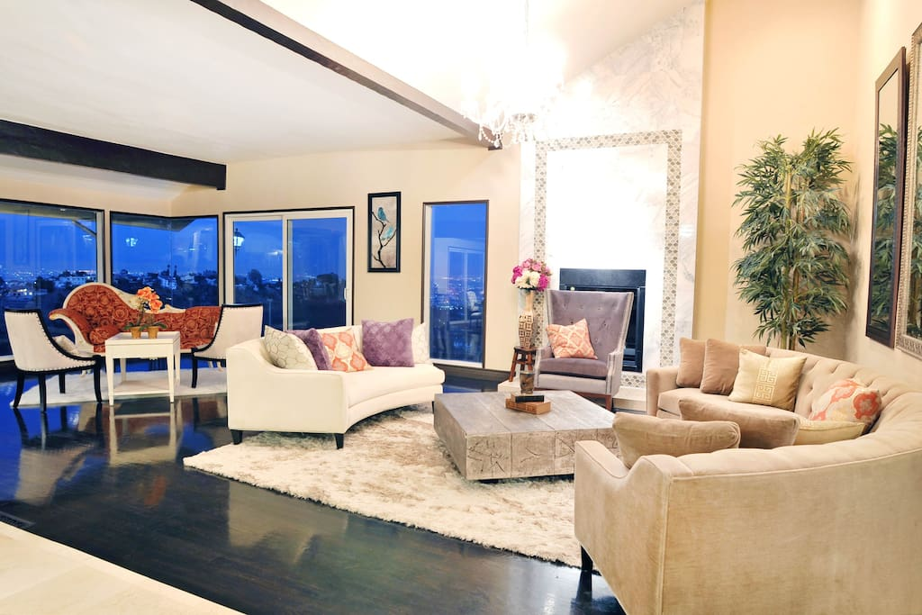 Great room with marble fireplace and two sitting areas. Explosive vista, city and ocean views with wraparound deck.
