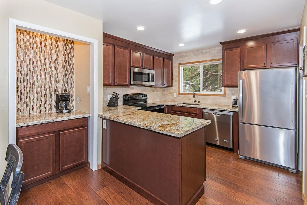 Updated kitchen and coffee bar. Granite countertops, dishwasher and all the tools to cook or BBQ