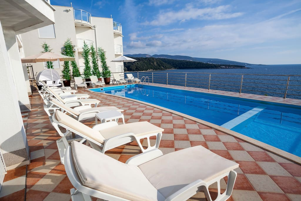 You can enjoy the sun near the swimmimg pool and watch the sea at the same time