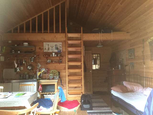 Inside second house. Bathroom with shower and washingmachine in the back. Sleeping loft with videogames for kids, (young and old).