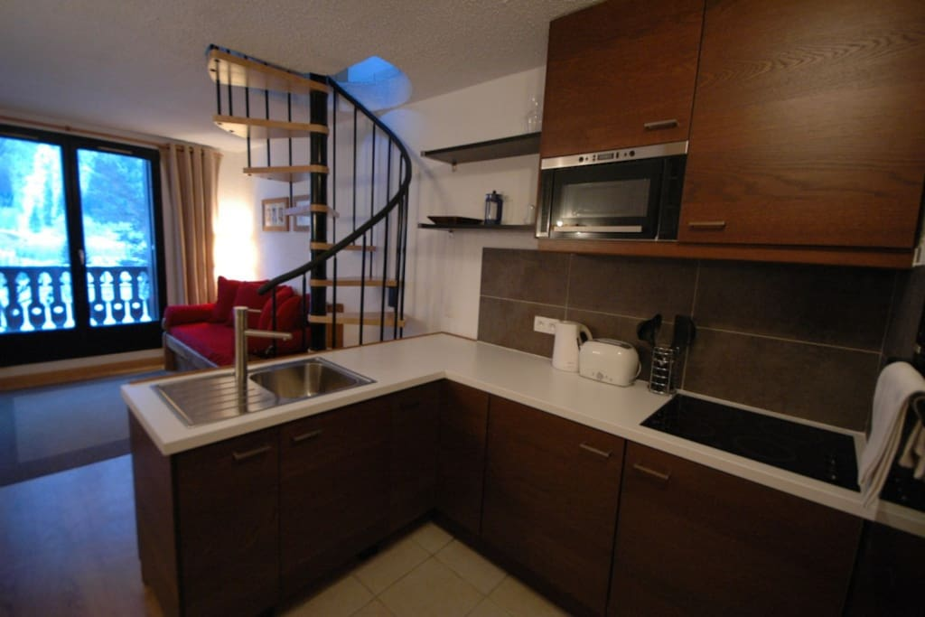Spacious kitchen & stairs to bedroom