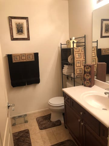 Bathroom which includes towels and toilet paper.
