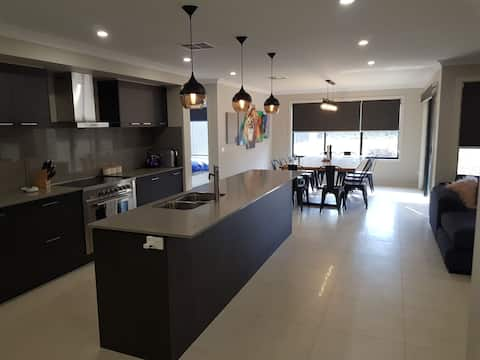 Brand new home on 3/4 acre stones throw from water