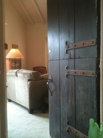 Beautiful old hand-crafted door was made by original owner 75 years ago.