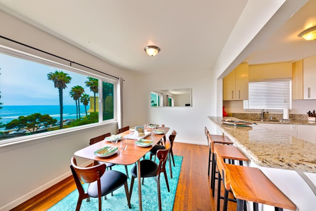Sweeping views from kitchen and dining areas make seaside living real!