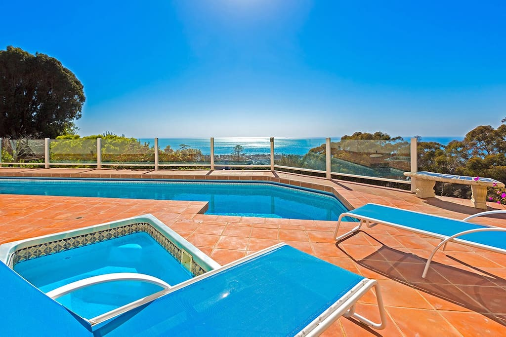 Hot tub and heated pool with stunning views of the Pacific Ocean
