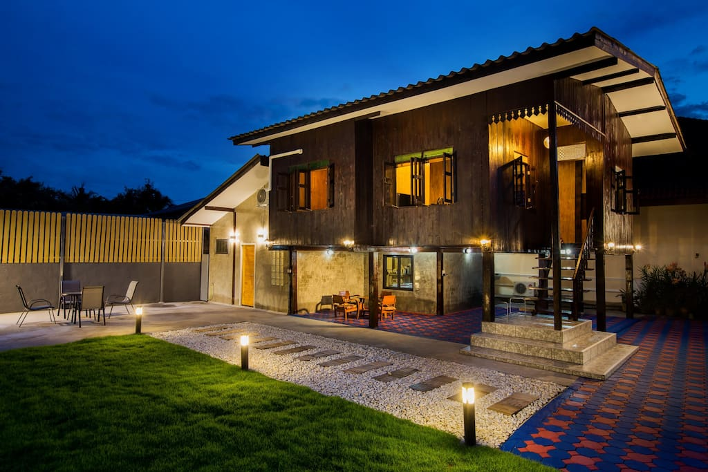 The night makes the teak house all the more stunning.