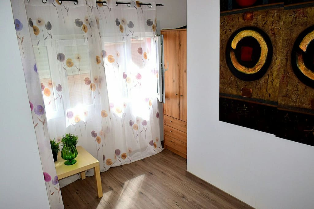 Double bedroom, perfect for 2 persons. The rest of the house is shared with other guests: kitchen - possibility for cooking, living and dining room, 2 bathrooms.