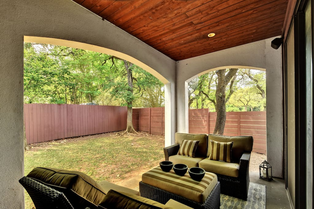 The back patio is made for relaxation - settle into those comfy cushions.