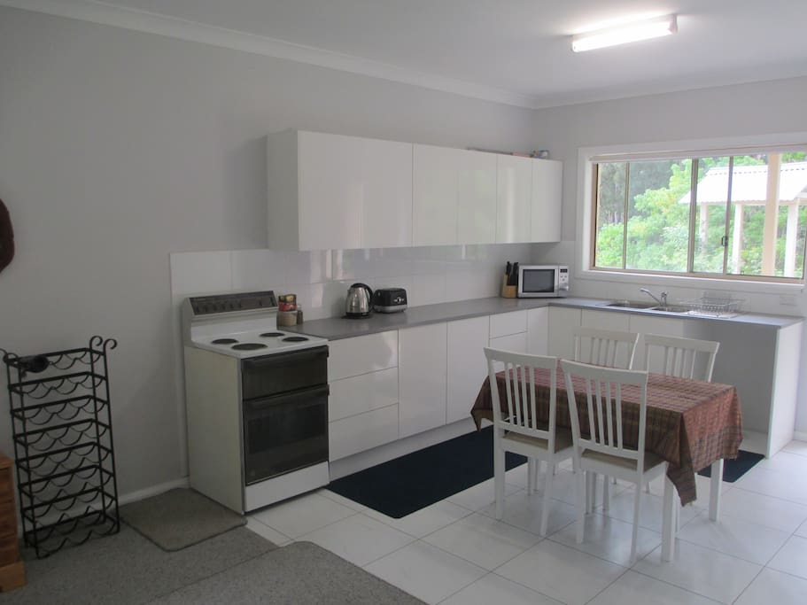 Full kitchen with compact eat-in dining area