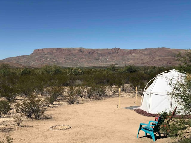 The tent is in the back portion of the property which is accessed down the Terlingua Trail