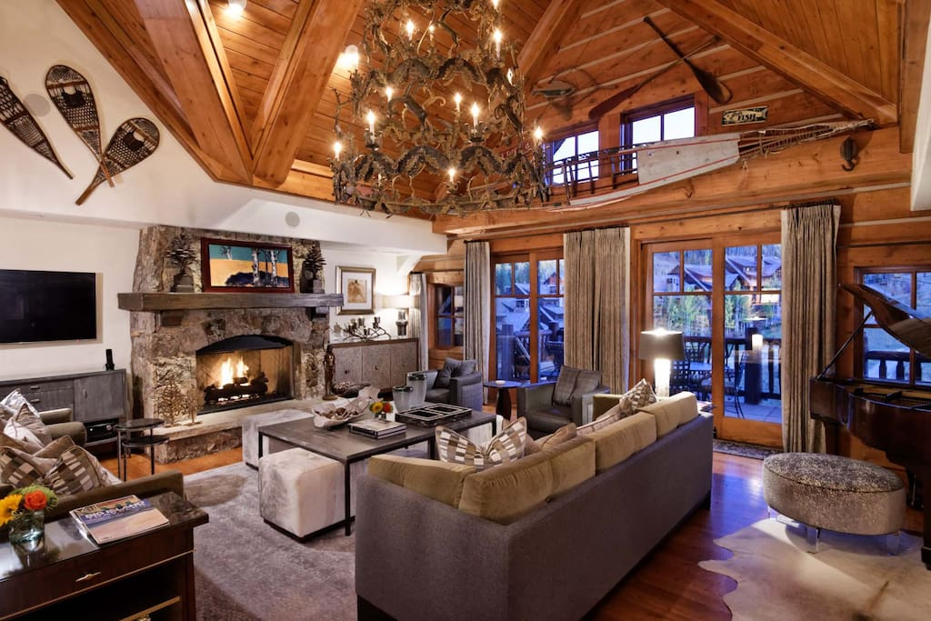 Hardwood floors and two-story vaulted ceiling add to the elegance.