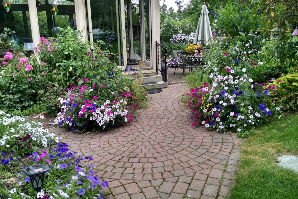 Walkway to patio with beautiful gardens