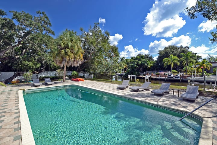 Canal front home with large heated pool