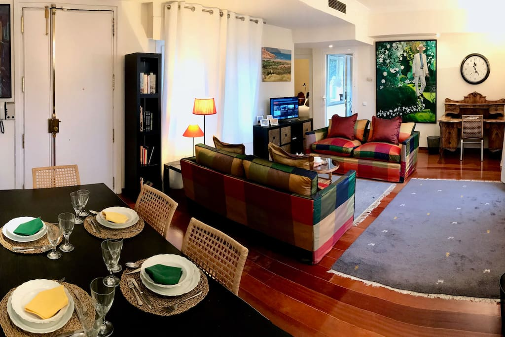 a panoramic view of the large living room with dining area