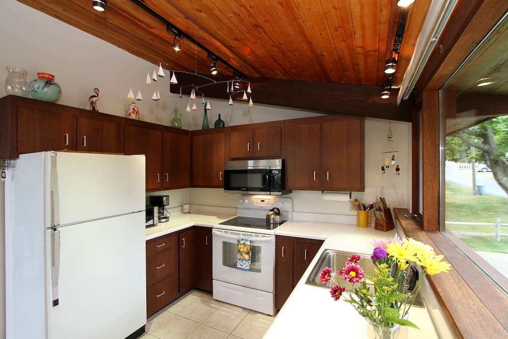 A spacious kitchen is a pleasure to cook in with a full suite of appliances and views from a long window.