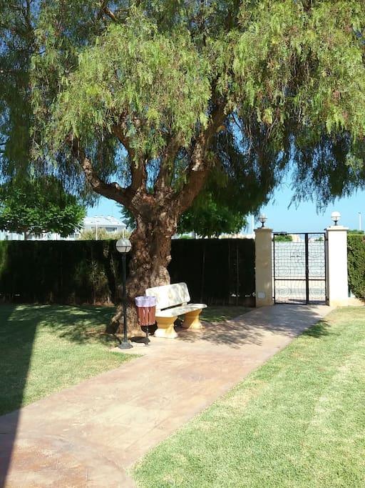 Gate to Arenal Beach in Garden area