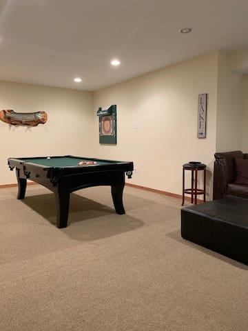 Pool table and dart board on lower level.
