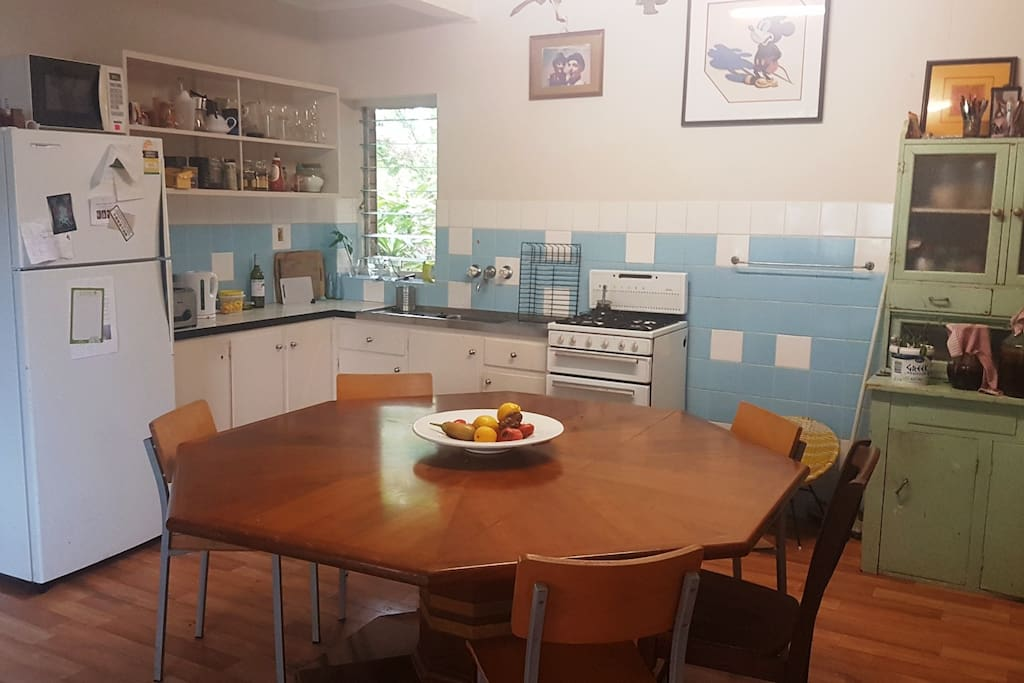 The kitchen is spacious and light with a large, octagonal dining table