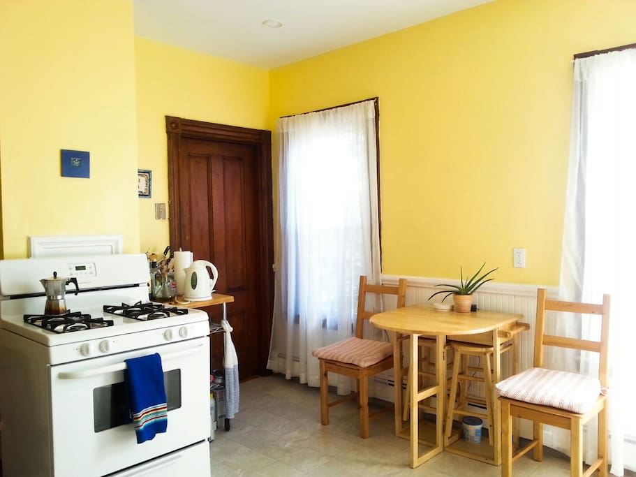 The kitchen has a gas stove, microwave, dishwasher & plenty of dishes & utensils