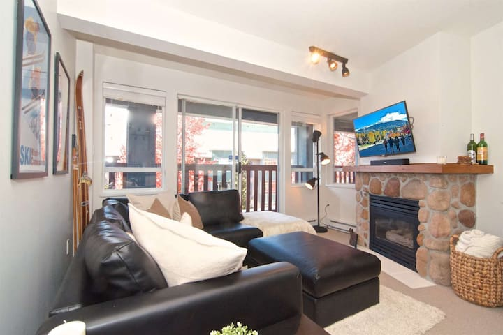 Access to huge Village stroll facing covered deck...Gas fireplace and wall mounted TV