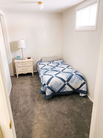Bedroom with twin bed and closet.