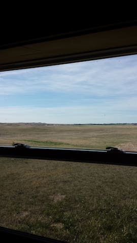 View from behind the leather couch to our cattle and pastures