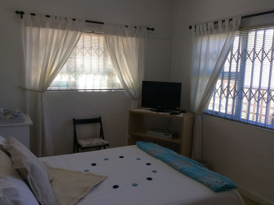 Double bed showing tv with  dstv and free wifi