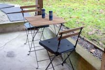 Enjoy a little time for yourself on your own little bistro table outside.