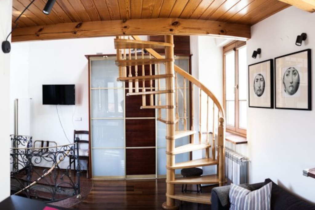 Living space and stairs to the sleeping area.
