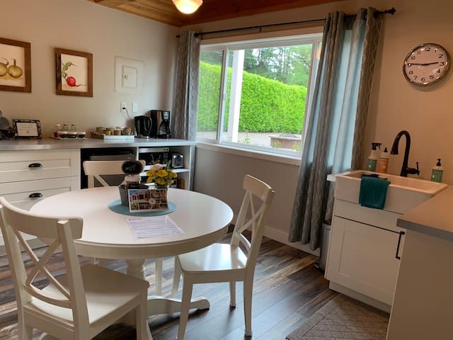 Comfortable kitchen and dining area, full of light