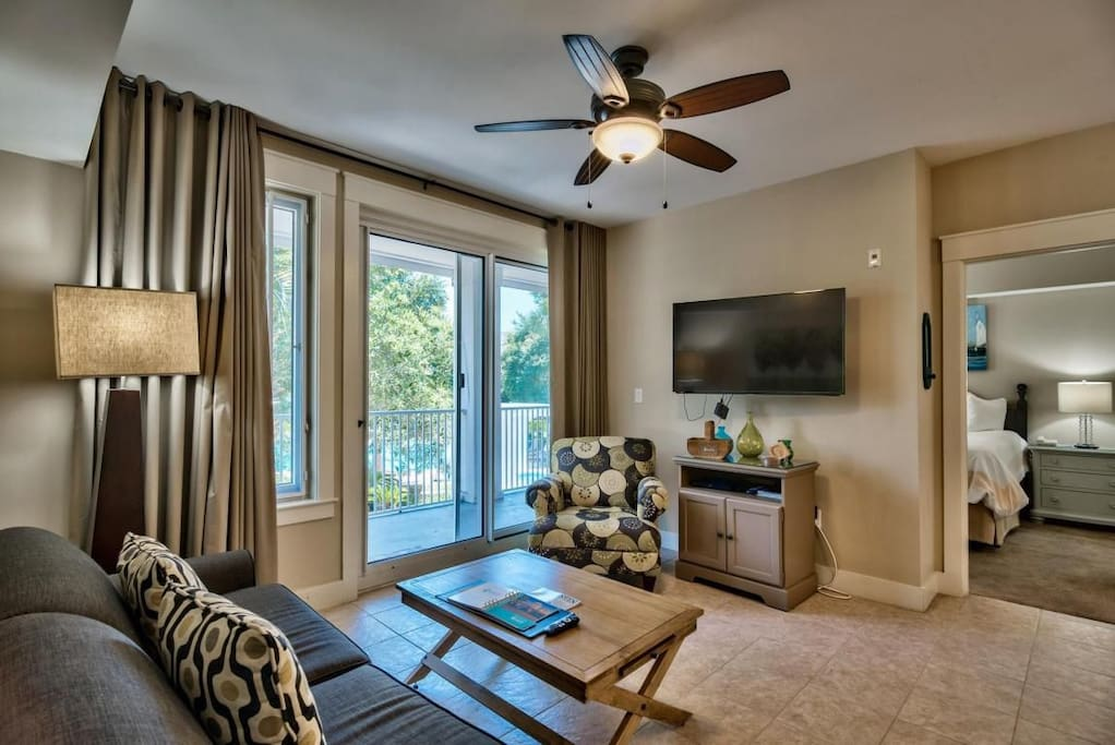 The large 49'' mounted flat screen TV can be viewed from the living room & the kitchen!