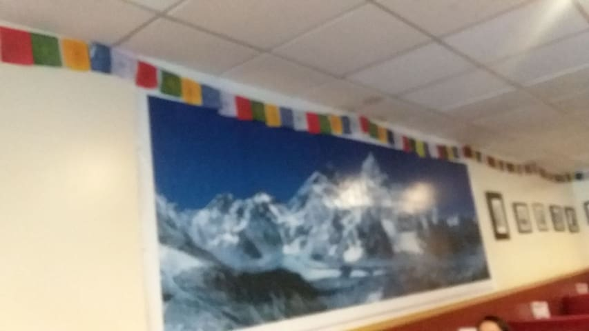 Photo of Mt. Everest and surrounding Peaks at one of my favorite restaurants, Guru's Himalayan Food, walking distance from the AG house. (8 Blocks)
