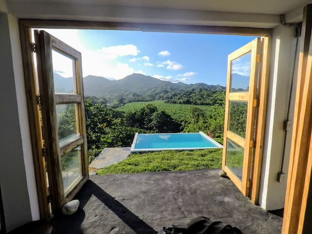 Amazing view. Top of the hill pool.Jungle house