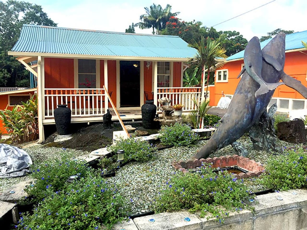 Orchid suite cottage, after recent remodeling.Hand made whale with baby statue mounted in front of Orchid suite.