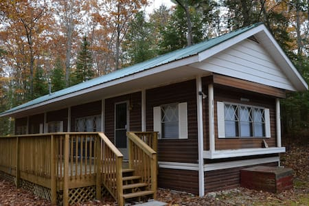 Wooded Up North Retreat Steps from Lake Huron