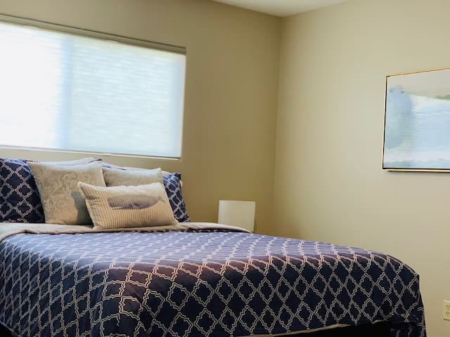 Bedroom #2 with comfy linens and a spacious closet