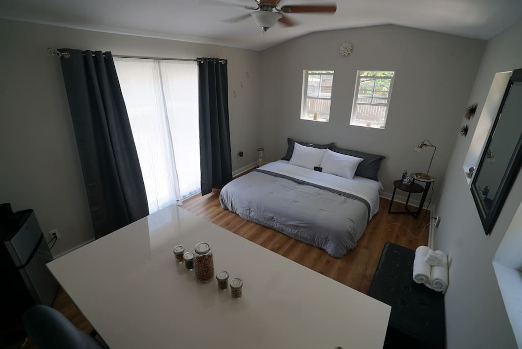 The lockable detached studio hosts two, high-quality pillow top mattresses (pushed together to make a King), large desk & office chair, storage, mini-fridge (with ample fridge and freezer space), microwave, coffee maker, and it's own AC unit. The perfect get-away retreat!