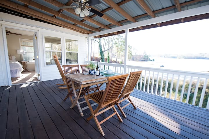 Have coffee on the covered deck, situated off of the master bedroom with surrounding lake views.