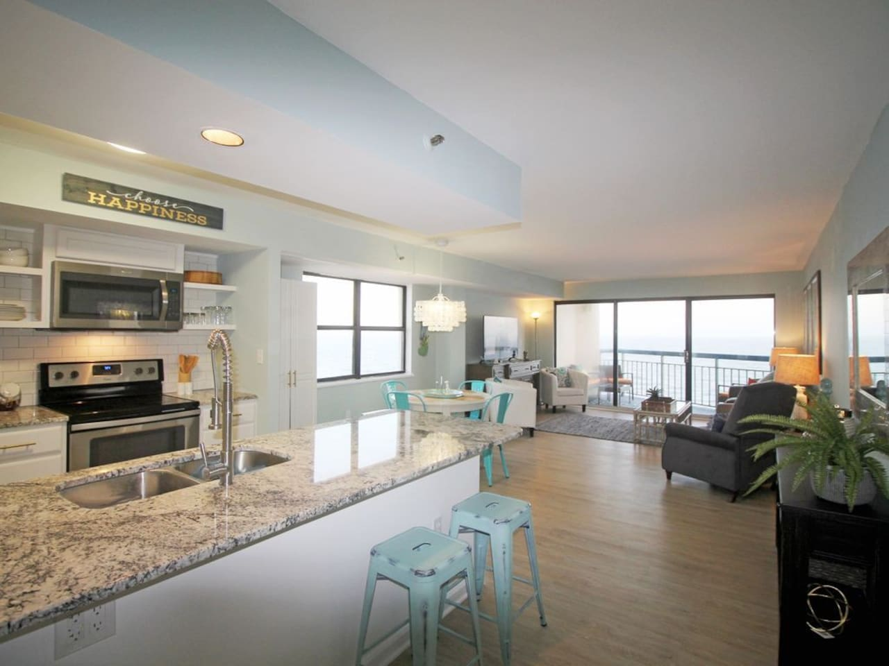 Direct Ocean Front Condo with Panoramic views! Stylishly renovated with tasteful beachy decor.