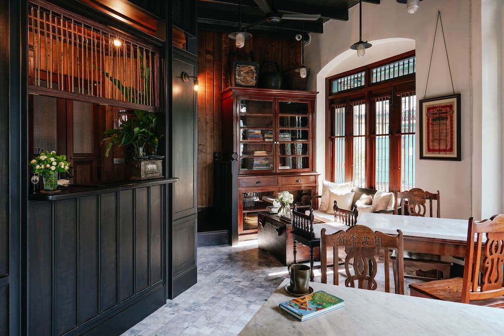 """Originally believed to have been a tea house, on one corner of a well-preserved Thai-Chinese colonial styled residential city square, an adjacent pair of meticulously restored two-storied shophouses offers a very small and friendly """"home from home"""""""