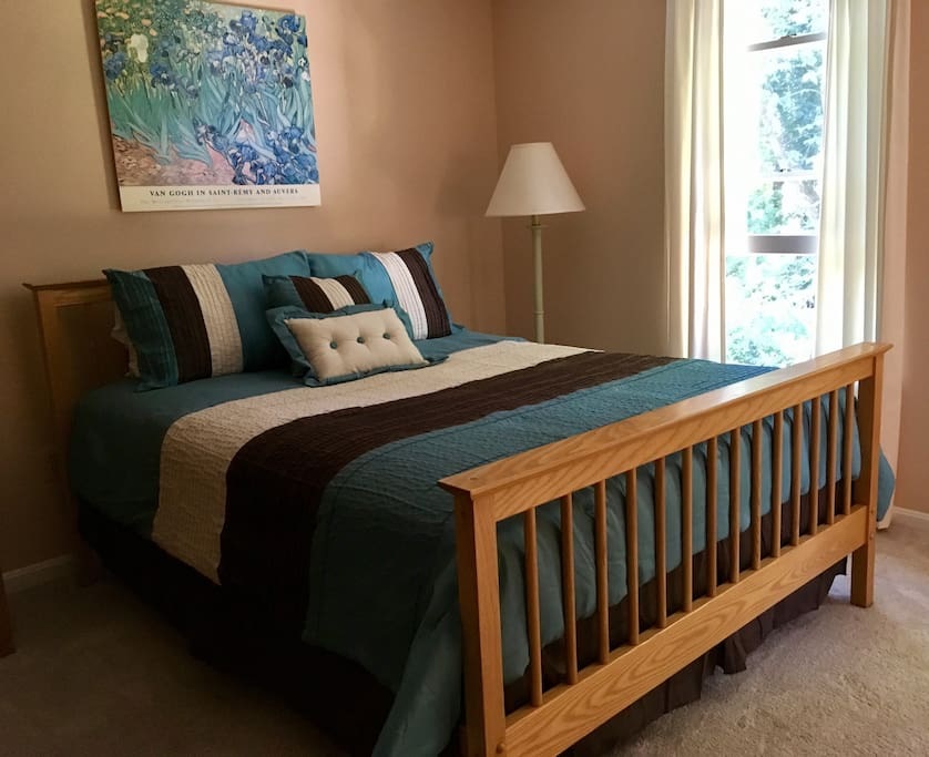 Your large private bedroom comes with a comfortable queen bed and an attached private bathroom.