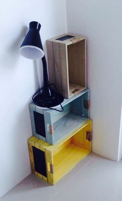Country-feel corner with crates you can stack up to make your DIY side table... or you can opt for a boring side table  which we also have